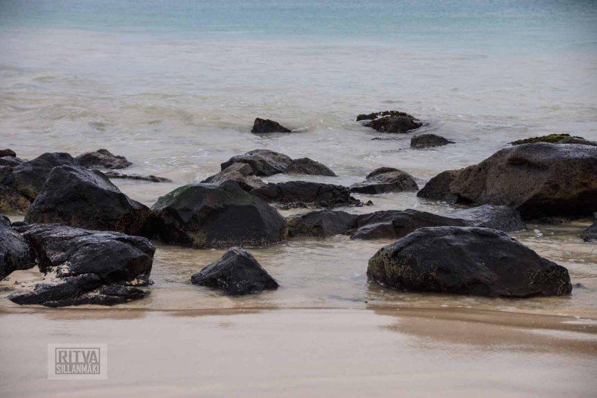 sand sea and rocks