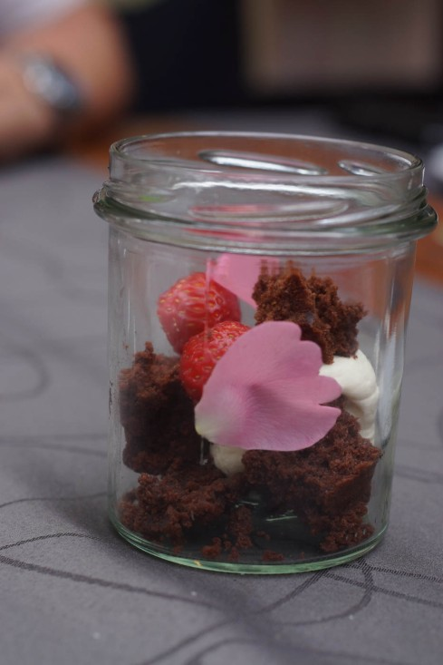 Chocolate cake with strawberry and cream